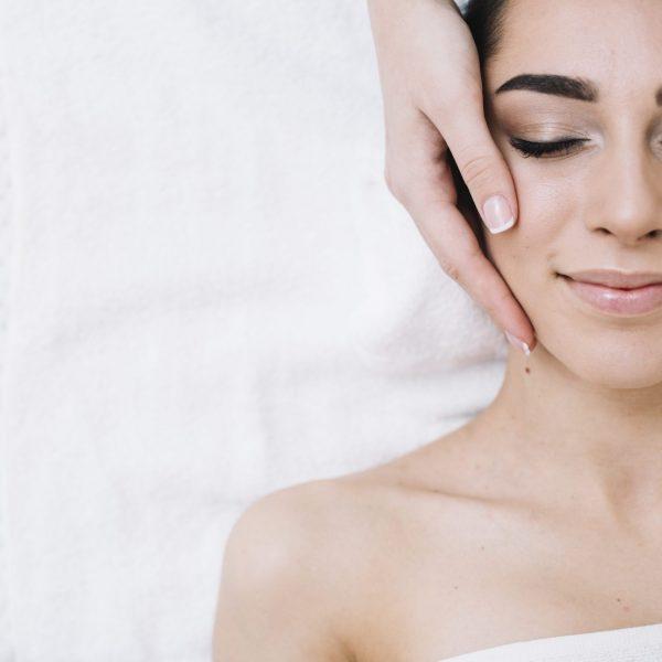 hands on face woman massage